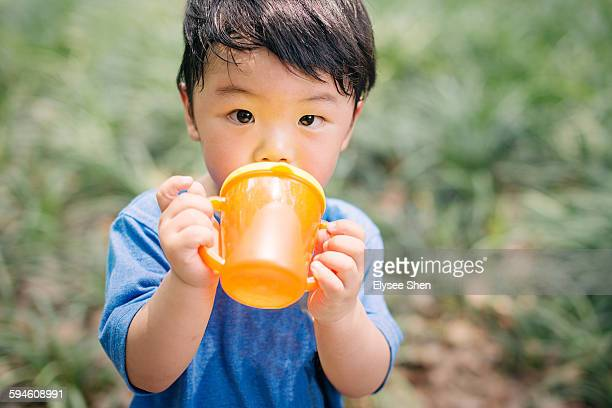 Boy holding a water cup