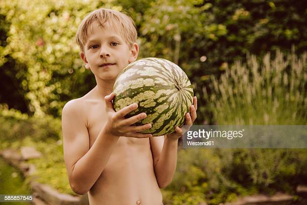 Boy holding a water melon