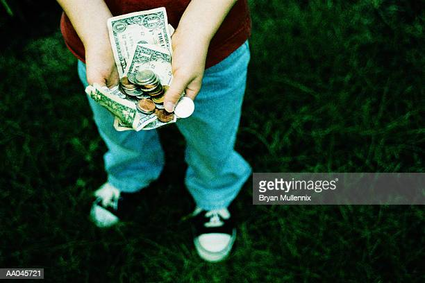 boy holding allowance money - handful stock pictures, royalty-free photos & images