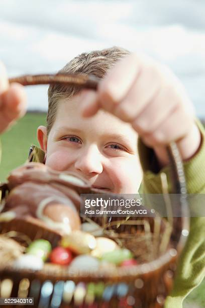 Boy holding an Easter basket filled with chocolates