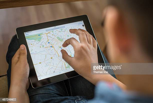 Boy holding an ipad on which Google Maps is opened on June 09 in Berlin Germany The apple iPad is really popular among young children Photo by Thomas...
