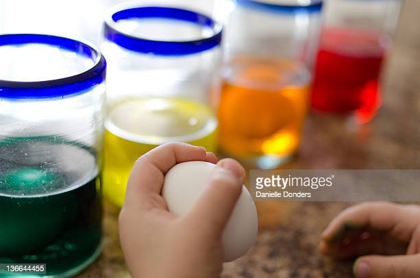 """boy holding and glasses full of colored dye - """"danielle donders"""" stock pictures, royalty-free photos & images"""