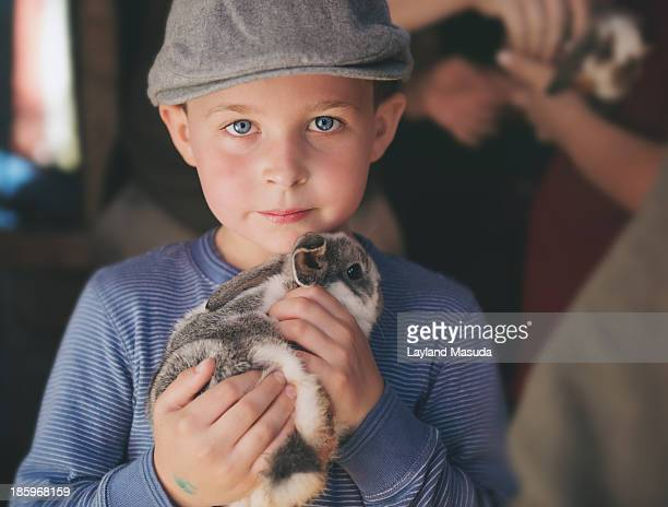 Boy Holding Baby Bunny