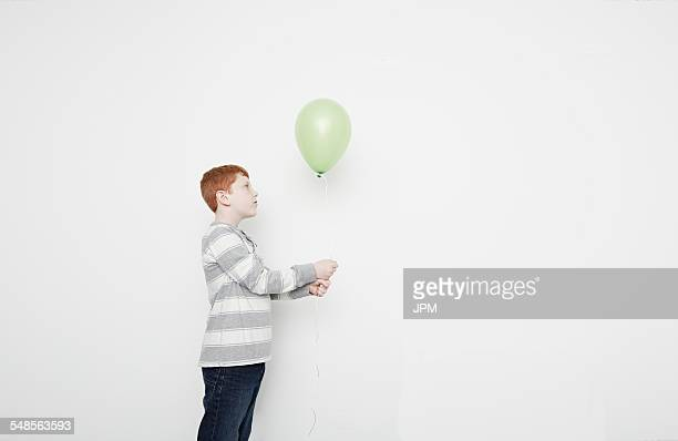 Boy holding balloon