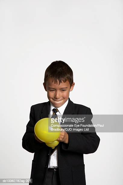 """boy (6-7) holding balloon - """"compassionate eye"""" fotografías e imágenes de stock"""