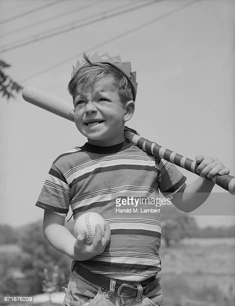 boy holding baseball and baseball bat - {{ contactusnotification.cta }} stock pictures, royalty-free photos & images
