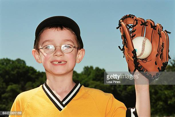 boy holding baseball in glove - baseball catcher stock pictures, royalty-free photos & images