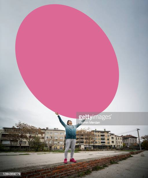 boy holding big circle on city street - person holding blank sign stock pictures, royalty-free photos & images