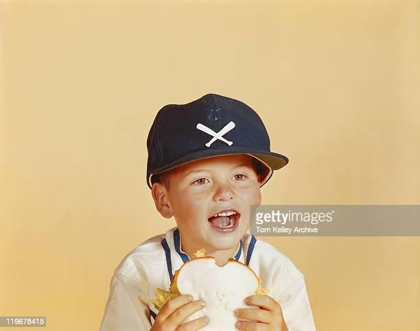 Boy holding bread, close-up