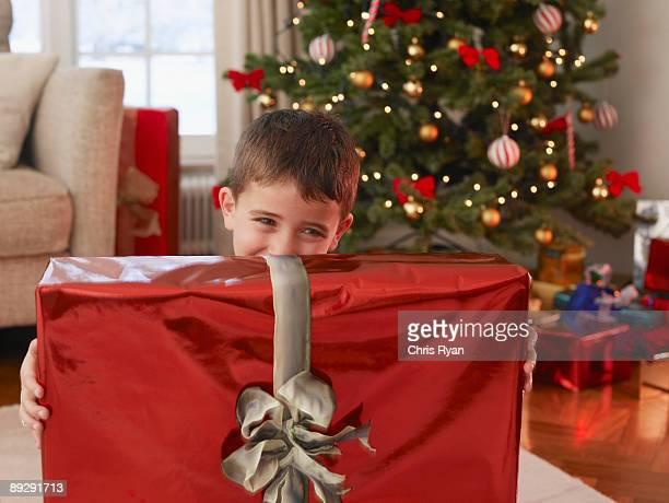 Boy holding Christmas gift