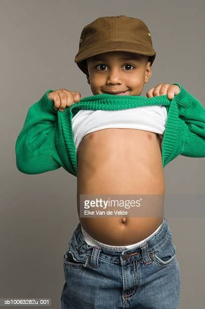 Boy (3-4) Holding Clothes to Show Belly, Portrait