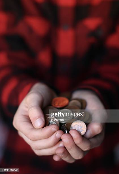 Boy holding coins in his hands.