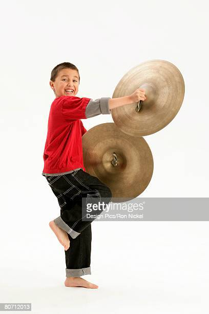 A boy holding cymbals
