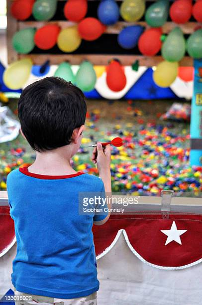 boy holding dart - chatham new york state stock pictures, royalty-free photos & images