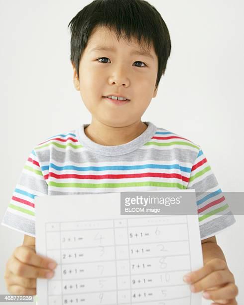 Boy Holding Exam Paper