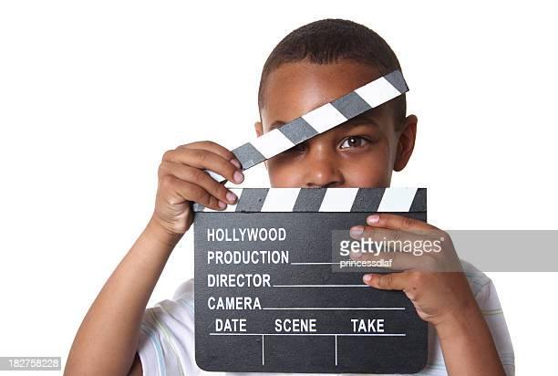 Petit garçon tenant Clap de cinéma