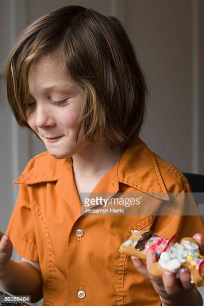 Boy holding gingerbread cookie