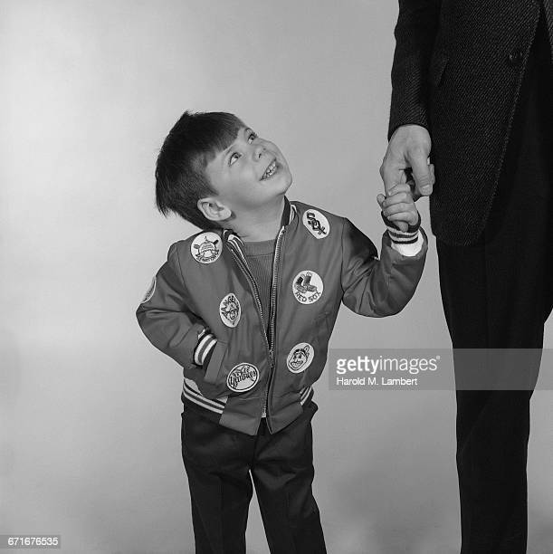 boy holding hand of man and smiling - {{relatedsearchurl(carousel.phrase)}} stock pictures, royalty-free photos & images