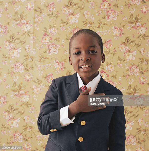 boy (9-11) holding hand to chest, portrait - truth be told stock photos and pictures