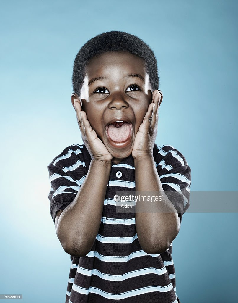 Boy (2-4) holding hands to face, shouting : Stock Photo