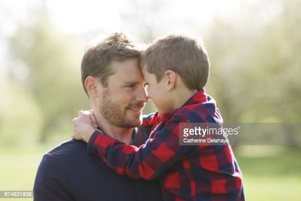 A boy holding his father