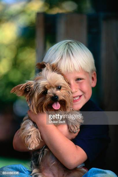 Boy Holding His Yorkshire Terrier