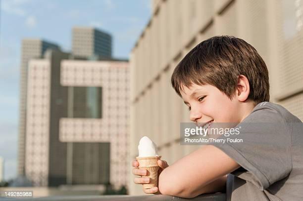 Boy holding ice cream cone, portrait