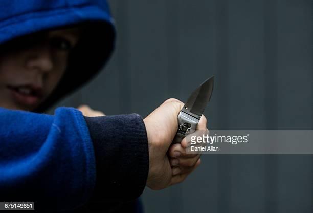 Boy Holding Knife