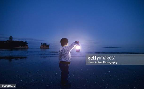 Boy Holding Lamp Outdoor.