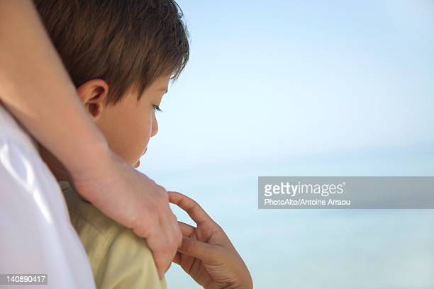 Boy holding mother's hand, cropped