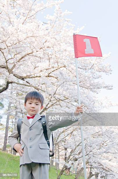 A Boy Holding No.1 Flag