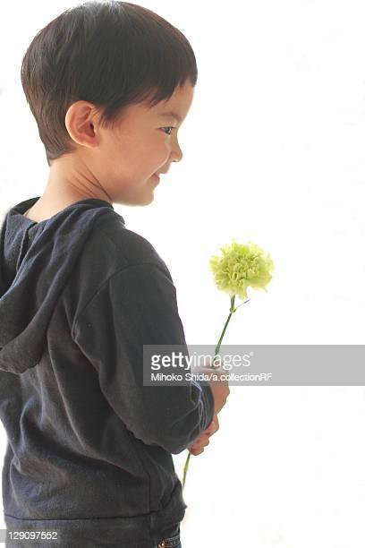 Boy Holding One Flower