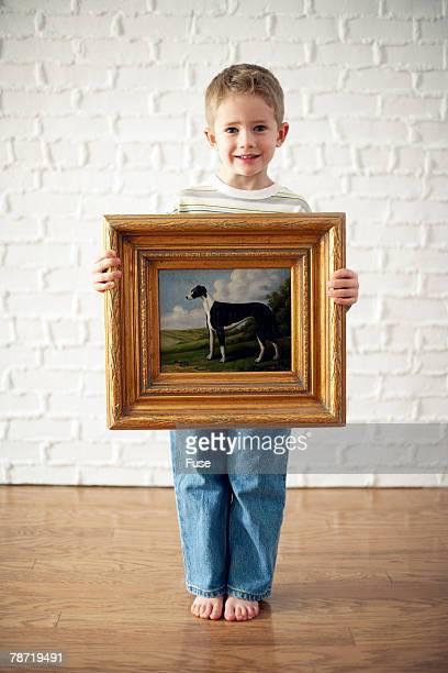 Boy Holding Painting of Dog