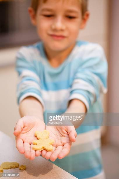 Boy holding piece of dough