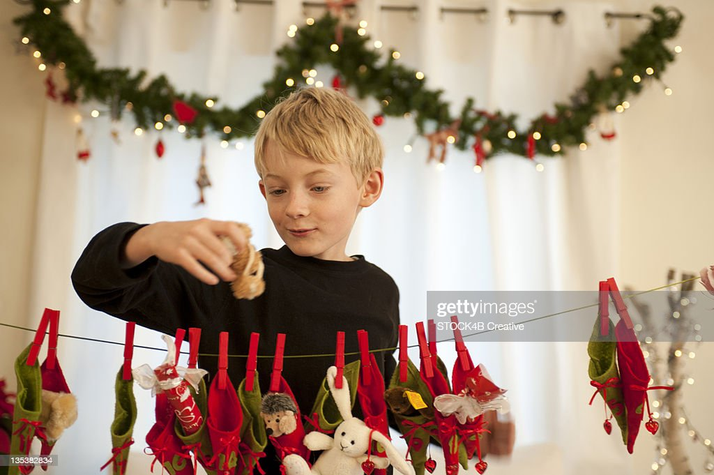 Boy holding present from Advent calendar : Stock Photo