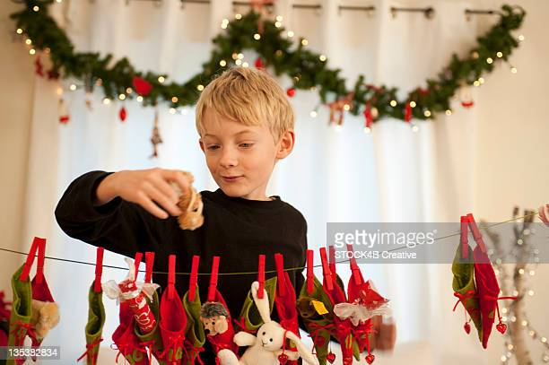 Boy holding present from Advent calendar