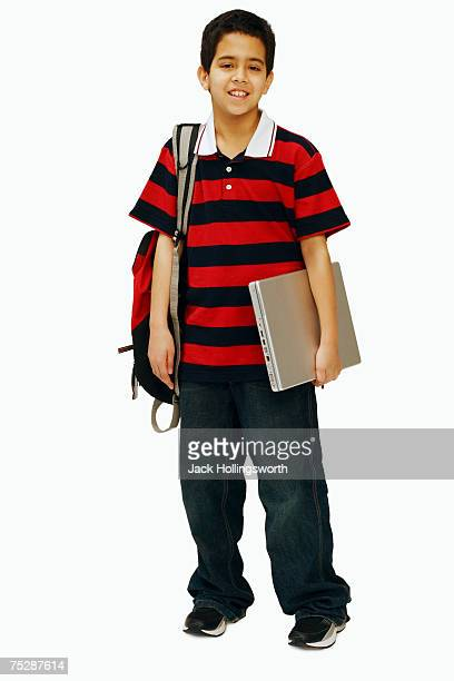 Boy (11-12) holding schoolbag, book, portrait