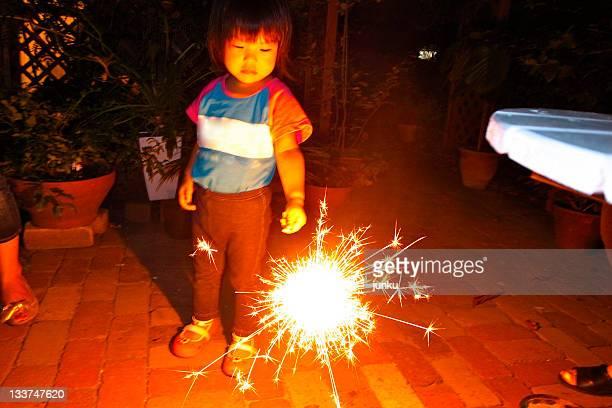 Boy holding sparkler
