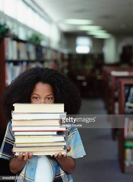 boy holding stack of books - textbook stock pictures, royalty-free photos & images