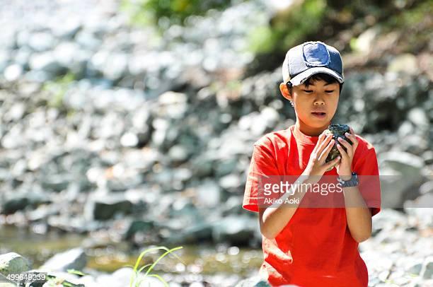 Boy holding stone