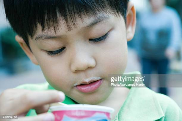 Boy holding sweet snack, close-up