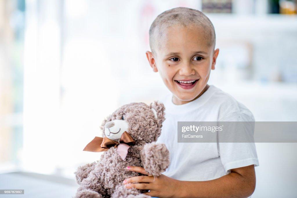 Junge mit Teddy Bär : Stock-Foto