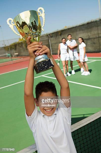 Boy Holding Tennis Trophy