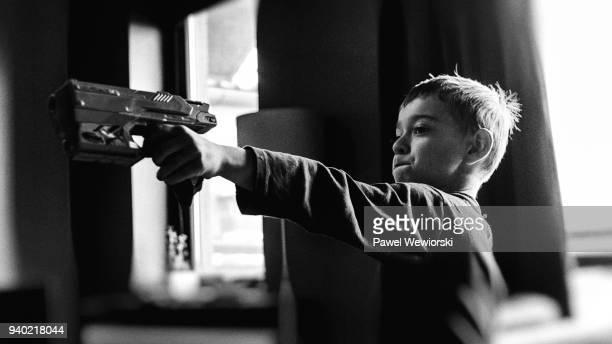 Boy holding toy gun