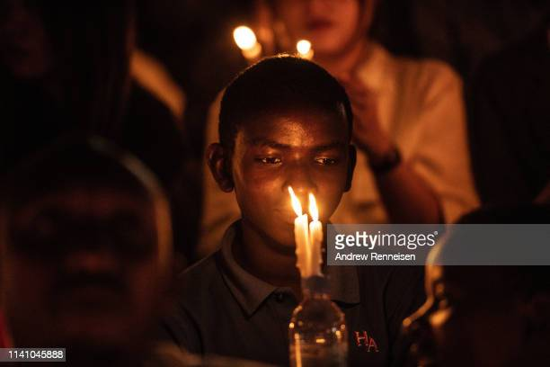 A boy holds a candle during a commemoration ceremony of the 1994 genocide on April 07 2019 at Amahoro Stadium in Kigali Rwanda The country is...