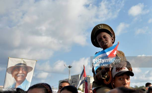 TOPSHOT A boy holds a Cuban national flag during the May Day rally at Revolution Square in Havana on May 1 2018