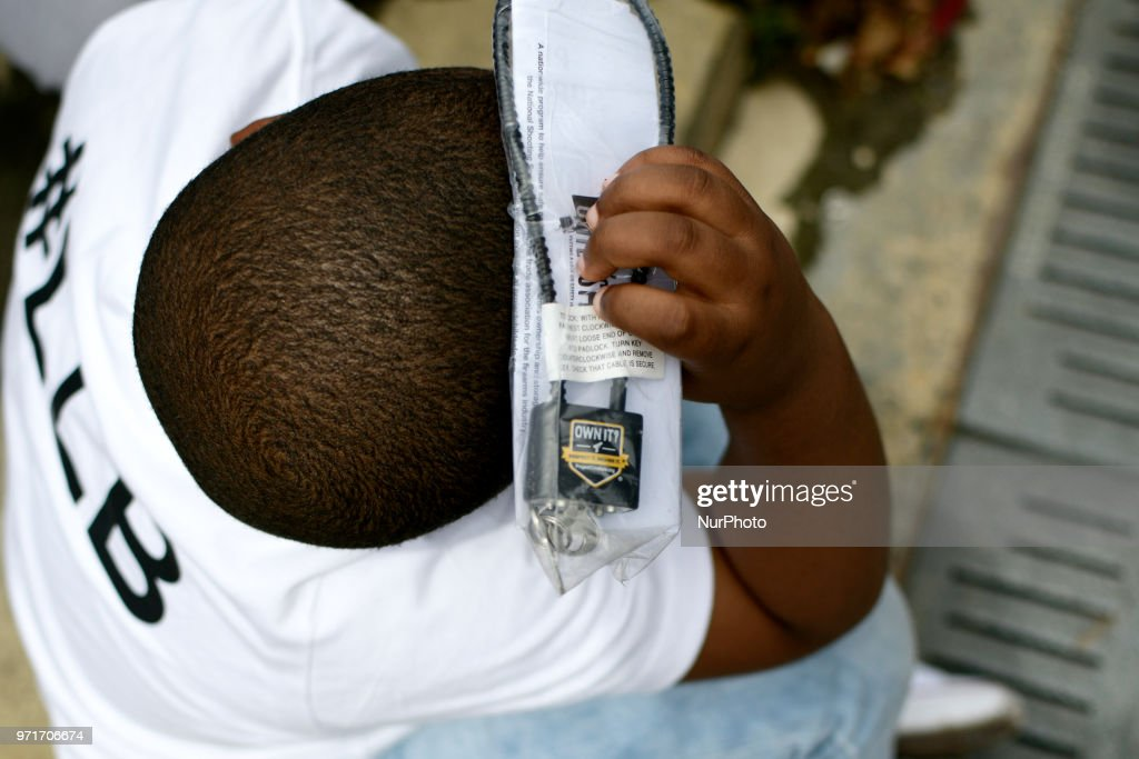A boy holds a gun lock above his head at an anti gun violence rally on the Art Museum steps, in Philadelphia, PA, on June 11, 2018. The 3rd annual Fill the Steps Against Gun Violence gathering is to raise awareness on the deadly epidemic and is organized by columnist Helen Ubinas.