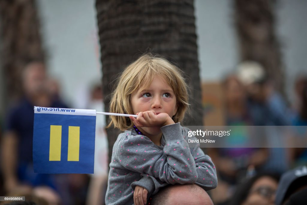 A boy holds a Human Rights Campaign Equality Flag at the #ResistMarch during the 47th annual LA Pride Festival on June 11, 2017, in the Hollywood section of Los Angeles and West Hollywood, California. Inspired by the huge womenÕs marches that took place around the world following the inauguration of President Donald Trump and by the early pride demonstrations of the 1970s, LA Pride replaced its decades-old parade with the #ResistMarch protest to promote human rights by marching from Hollywood to West Hollywood.
