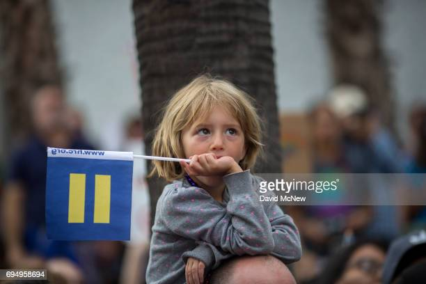 A boy holds a Human Rights Campaign Equality Flag at the #ResistMarch during the 47th annual LA Pride Festival on June 11 in the Hollywood section of...