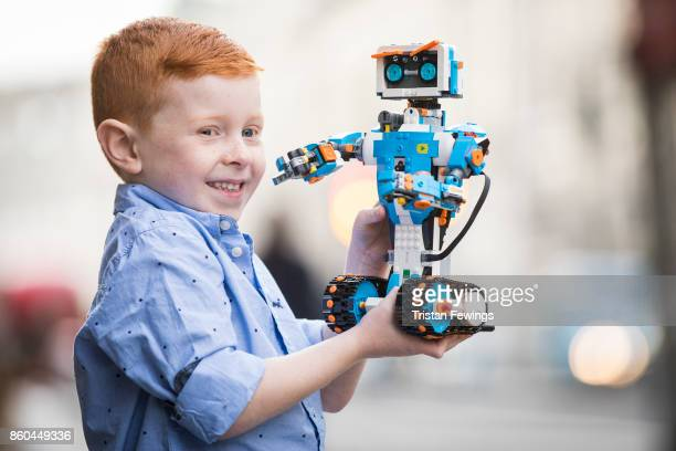 A boy holds a LEGO Boost robot as Hamley's announce it's top ten toys for Christmas at Hamleys on October 12 2017 in London England